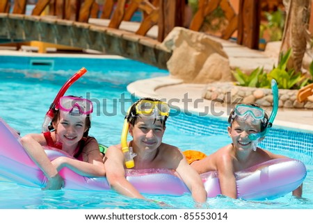 Children scuba diving - stock photo