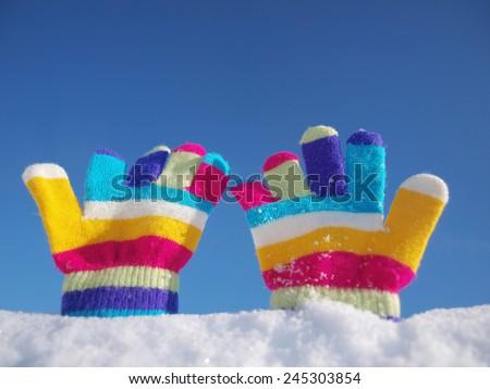 children winter gloves in snow - stock photo