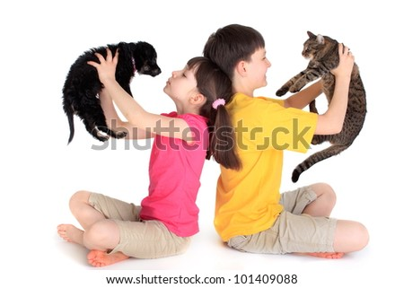 Children with family pets. - stock photo