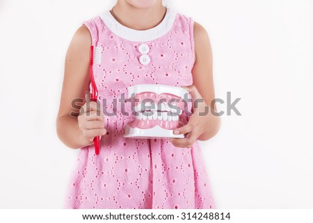 children with gloves showing on a jaw model how to clean the teeth with tooth brush - stock photo
