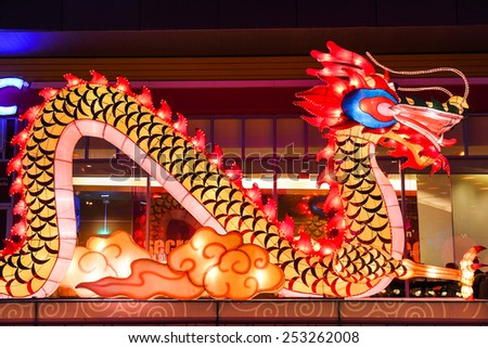 Chinese Dragon Lantern light up for Chinese happy new year front of department store - stock photo