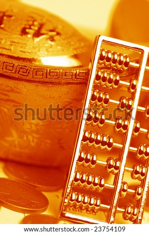 chinese gold ingots and abacus,coin - stock photo