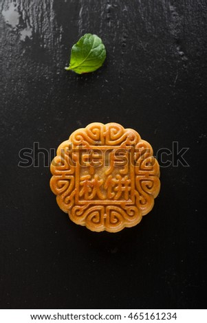 Chinese moon cake on a black background