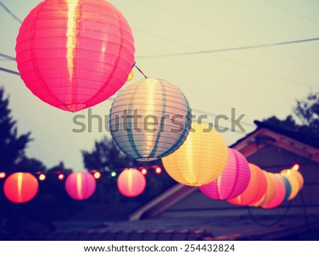 Chinese Paper Lanterns at a party during the evening toned with a retro vintage instagram filter app or action  - stock photo