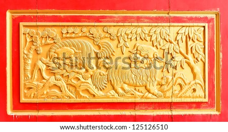 (Chinese style wood carving), which is part of the door in temple Tham Khao noi     Kanchanaburi, Thailand (in Thailand, temple is a public place). - stock photo