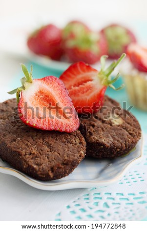 Chocolate cake with cream and fresh strawberries