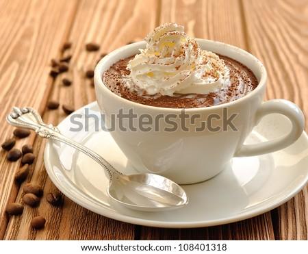 Chocolate dessert with whipped cream - stock photo
