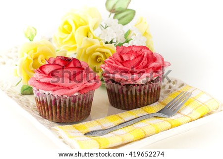 Chocolate muffin with sweet flowers