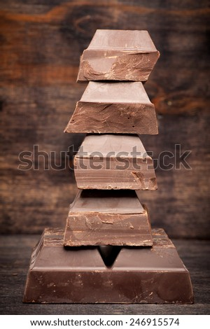 chocolate on wooden background - stock photo