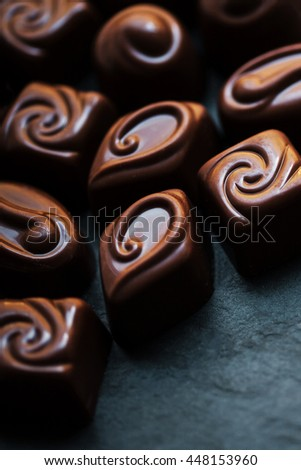 Chocolate over black background. Chocolate Candy, Cocoa. Assortment of fine sweets close up - stock photo