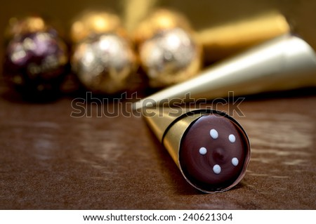 chocolate sweets in golden candy wrappers - stock photo