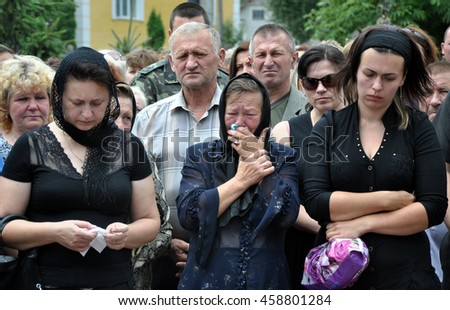 Chortkiv - Ternopil - Ukraine - July 9, 2014. The city Chortkiv say goodbye to fallen volunteer in ATO Gulko Oleg body of the coffin which was carried on in his home in Zalischyky