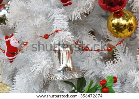 Christmas ball on white Christmas tree background ,White Christmas decoration with balls on fir branches with blurred background
