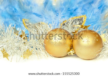 Christmas balls with tinsel and mask on white background