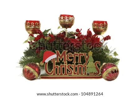 """Christmas by Candlelight"" -- A set of Christmas decorations make for perfect holiday display - stock photo"