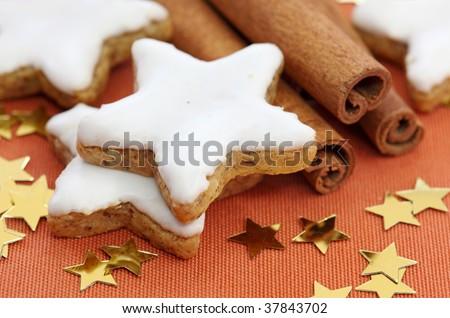 Christmas cakes on brown tablecloth - stock photo