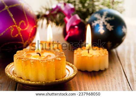 Christmas candles and decorations - stock photo
