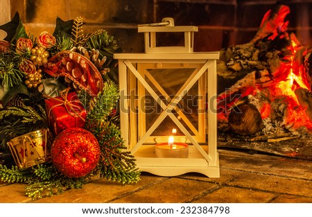 Christmas candlestick against the background of the fireplace, Christmas decorations - stock photo
