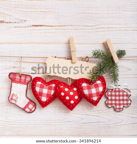 Christmas composition of toys handmade Christmas tree on a wooden background - stock photo