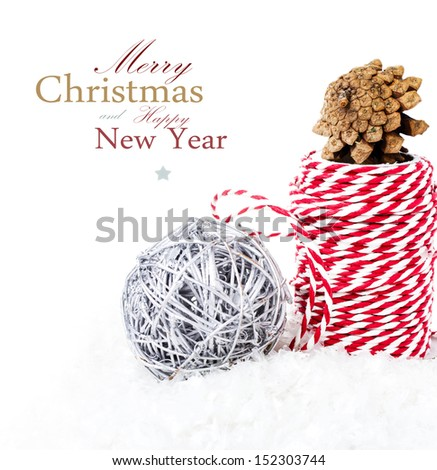 Christmas composition with ribbon decorations, ball  and snow cone  isolated on white background  (with easy removable sample text) - stock photo