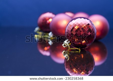 2015 Christmas Decoration. Red  baubles reflected in mirror - stock photo