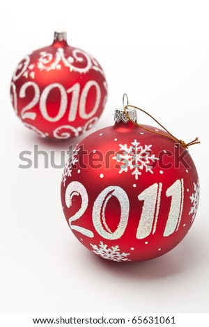 2011, 2010 Christmas decorations on white background - stock photo