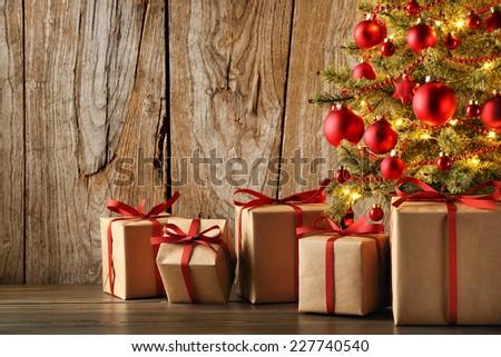 Christmas gift on grunge wood background - stock photo