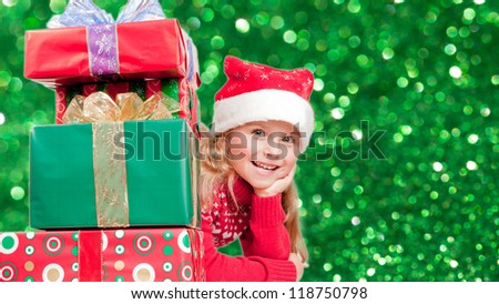 Christmas, kid, christmas presents - lovely girl enjoying Christmas - stock photo