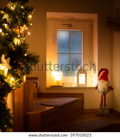 Christmas night.Window,elf,cosy Christmas decoration,snowfall