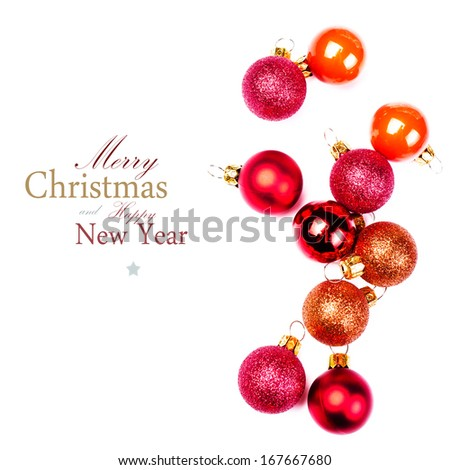 Christmas Ornaments isolated on white backhround. Festive glittering red balls close up with copy space for greeting text. - stock photo