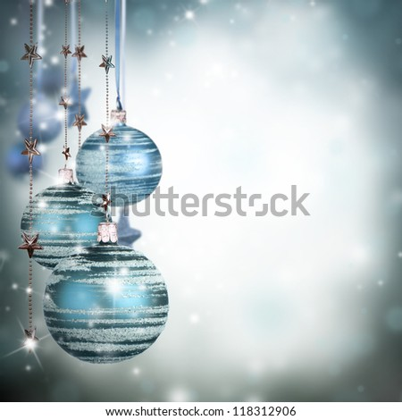 Christmas theme with blue glass balls and free space for text