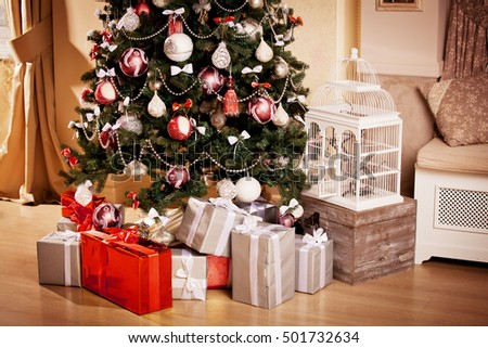 Christmas tree with lots of presents gifts in red and silver wrapper
