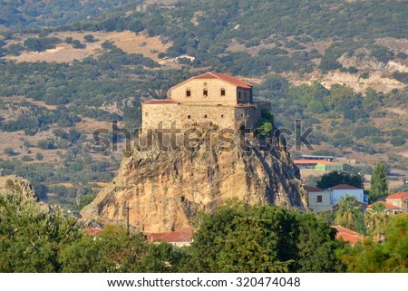 church of Our Lady of the Sweet Kiss sits atop a rock outcrop above the town of Petra, Lesbos - stock photo