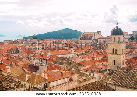 Church tower and red roofs in old town Dubrovnik, Croatia, UNESCO site, panoramic view  - stock photo
