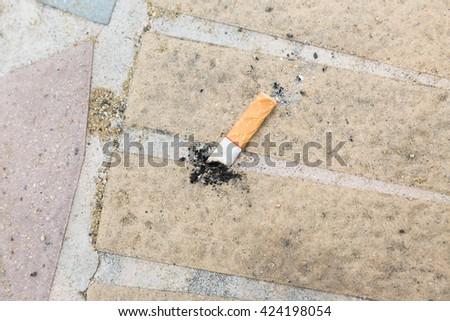 Cigarette stub on the floor  - stock photo