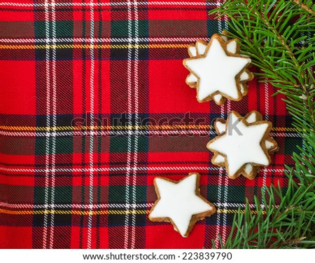 Cinnamon stars  on checkered background - stock photo