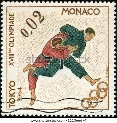 CIRCA 1964: A stamp showing karate in Tokyo olympic games, circa 1964