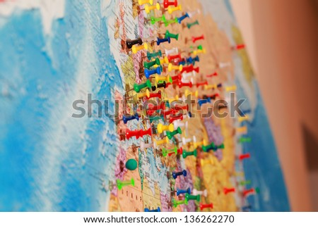 city on the world map marked buttons - stock photo