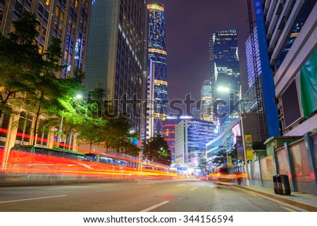 city road at night with dramatic light trails in guangzhou - stock photo