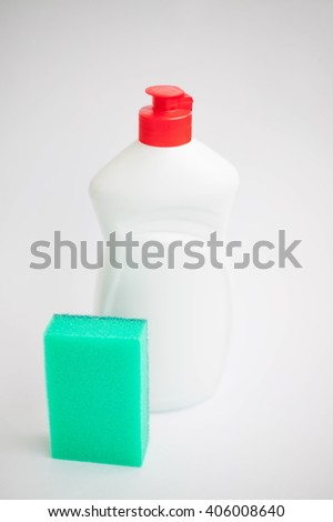 Cleaning sponge with scrub with detergent isolated on white background - stock photo