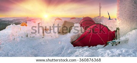 Climbers tradition to celebrate the New Year holiday on the highest peak of Ukraine - Goverla, Montenegrin Mountains. Severe frost danger destruction wind- climbing camp January 1, 2016 - stock photo