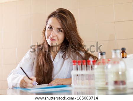 clinician working in laboratory. Model signs the model release - stock photo