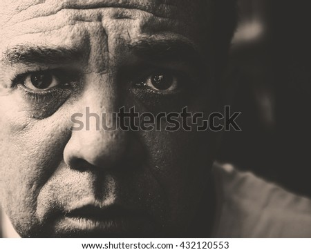 Close portrait up of a sad mature man. Monochrome photography