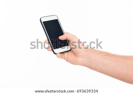 'Close-up cropped view human hand holding smartphone with blank screen, isolated on white
