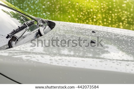 Close up headlight of white car with raindrops on. Car lamp. - stock photo