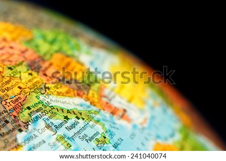 close-up macro photograph of map  Italy .Selective focus on Italy - stock photo