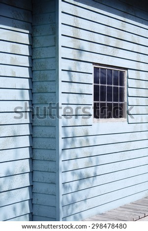 Close up of blue wooden building with window