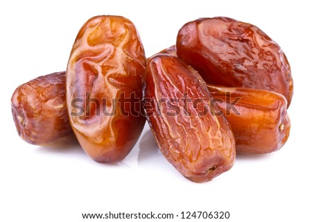 close up of dried dates on white background - stock photo