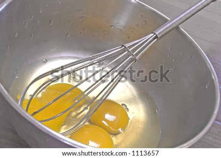 close up of eggs and mixing bowl - stock photo