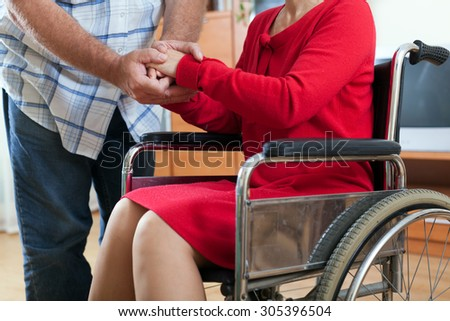 close up of invalid  woman's hands and senior man's hands - stock photo